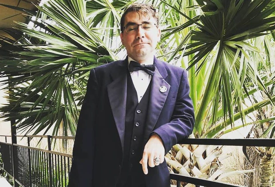 Mike Fredrick dressed in a tuxedo for the Krewe of Orpheus ball